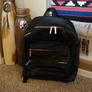 The Honest Co Black leather diaper backpack